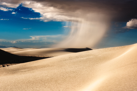A rain storm in White Sands National Monument Stock Photo
