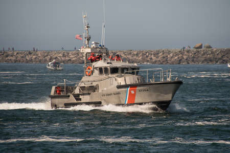 47 foot United States Coast Guard Motor Life Boat on patrol in the Tillamook Bay just inside of the Tillamook, Oregon, bar where numerous boats have sunk and lives have been lost. Taken on 09/10/2017.