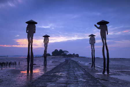 Four fishermen sculptures at low tide in kinmen, Taiwan
