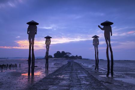 Four fishermen sculptures at low tide in kinmen, Taiwan