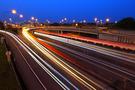 on the move: Car light trails on highway at night