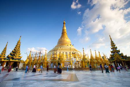 travelled: nidentified people walking around in Shwedagon pagoda Editorial