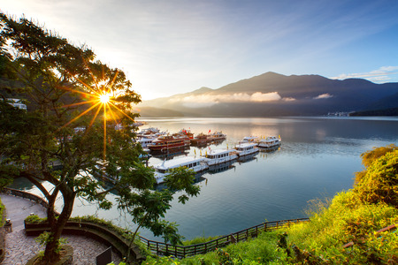 sunrise at sun moon lake in nantou, taiwan