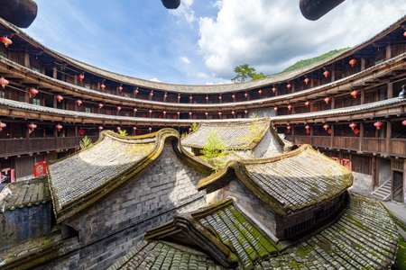 fu jian tulou (hakka roundhouse). The red paper with chinese words are couplets with lucky poem Editorial
