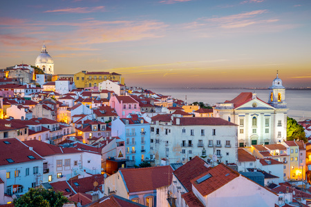 skyline of alfama at lisbon, portugal at dawn