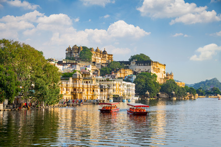 City Palace and tourist boat on lake Pichola. Udaipur, Rajasthan, India Editorial