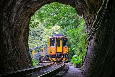 Train with Tunnel of Pingxi Line, Taiwan - Single-track railway branch line of the Taiwan Railway Administration, shot in Pingxi District, New Taipei, Taiwan.
