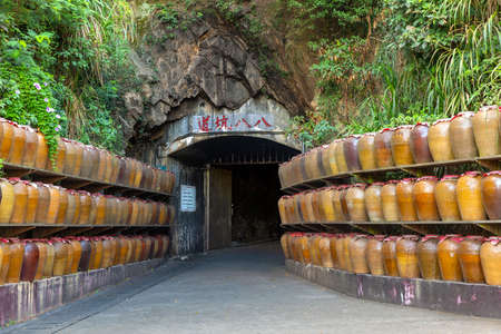 Tunnel 88, used for storage of locally distilled alcohol and spirits, tourist attraction on Nangan Island of Matsu in Taiwan. The Chinese text on the tablet: