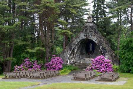 trees services: An outdoor Catholic church with colorful flowers.