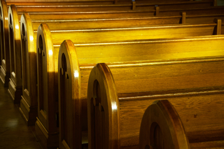 pews: A row of church benches. Stock Photo