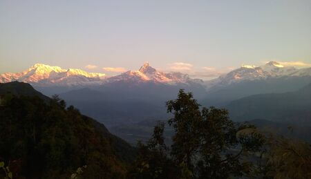 A view of the Himalayan mountains in the morning light.