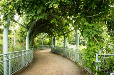 archways: An archway over a garden pathway. Stock Photo