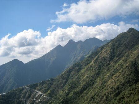 foothills: Cloudy skies over the Himalayan Foothills in Nepal. Stock Photo