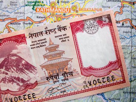 five rupee: A Nepali Rupee note on a Nepal Map.