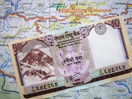 rupees: A Nepali Rupee note on a Nepal Map.