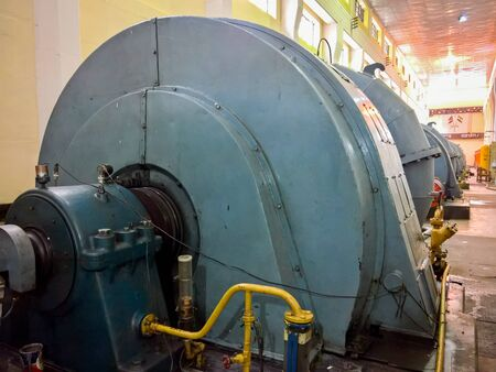 The generators and turbines in a hydroelectric plant.