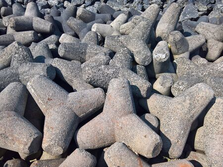 A bunch of concrete tetrapods along the ocean front. Stok Fotoğraf
