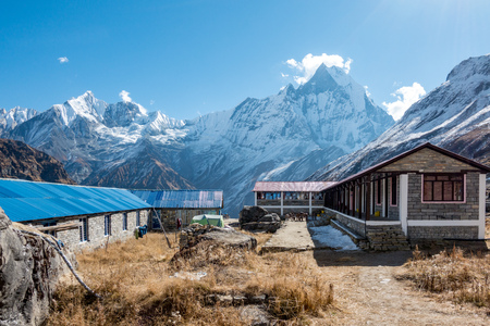A Stone House and Himalayan Mountains as a stop for weary trekkers. Stock Photo