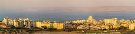The City of Tiberias by the Sea of Galilee in the light of the golden evening sun. Editorial