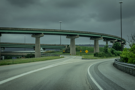 Some highway bridges and ramps on a major interstate highway under stormy skies. Reklamní fotografie
