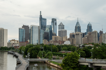 The city of Philadelphia, Pennsylvania alongside the river.
