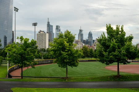 A park in the city with the skyline in the background.