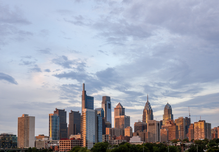 A view of the Philadelphia city skyline in the evening sun.