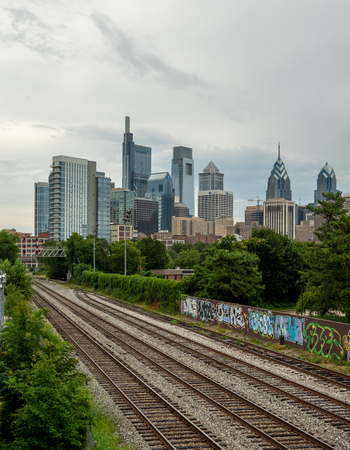 Railroad tracks in the city with the finacial district in the background.