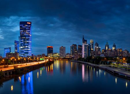 City lights of the Philadelphia skyline at nighttime.