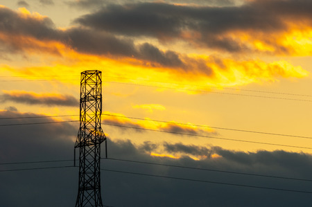 A sunset over the power lines or hydro wires.