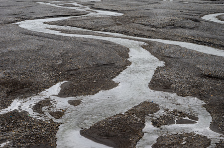 An abstract background of a river winding through the riverbed.