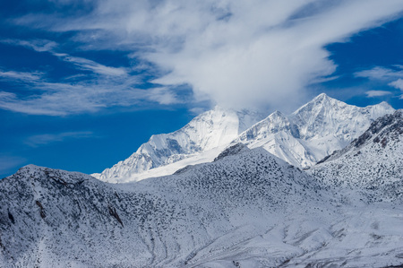 The beauty of the snow covered mountains in the Himalayan Mountain Range. Stock Photo