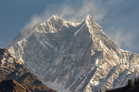 A beautiful sun bathed snow peak of the Himalaya Mountains. Stock Photo