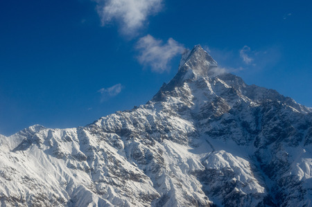 A beautiful View of Machapuchare or Fishtail Mountain in the Himalaya Mountain Range of Nepal. Stock Photo