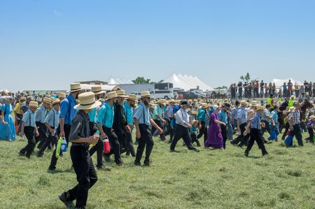 LEOLA, PA - JUNE 30, 2017: Amish people watching an equipment demonstration at the  Horse Progress Days  activities in Leola, Pensylvania on June 30, 2017.