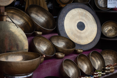 Some Tibetan singing bowls for sale in a shop.