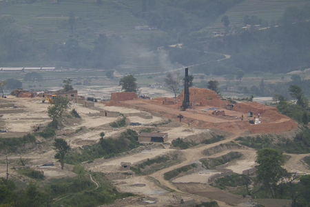 The pollution spewing out of the chimneys of brick kilns in Asia.