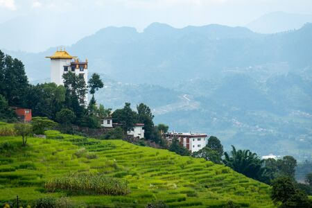 Some Buildings on a Terraced Hillside in Nepal. Stock Photo