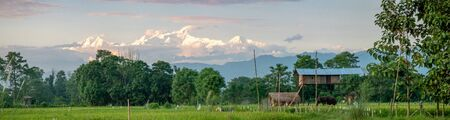 A Rural Farmland Setting in Nepal with mountains in the background.