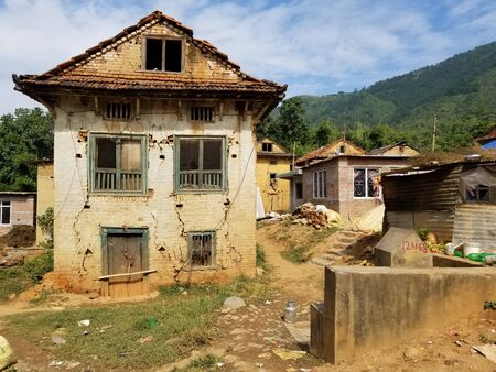 Some Earthquake damaged buildings in a village in Nepal.