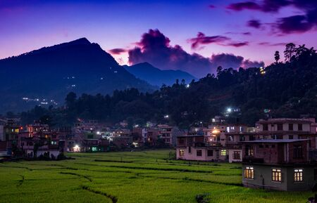 A beautiful sunset over a town in the foothills of the himalayas.