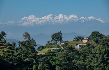 A background of the snow covered Himalaya Mountain Range in Nepal with a town in the foreground.