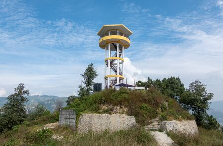 A view tower on the top of a mountain.