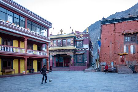 Kagbeni, Nepal - November 10, 2019: Some monks playing football at a Buddhist temple in the Himalaya Mountains.