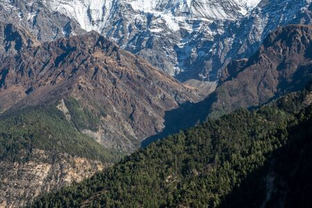 The beautiful Pine Covered Hills and Deep Valleys in the Himalaya Mountains of Nepal on the popular Annapurna Circuit trekking route in northern Nepal.