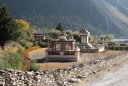 A Stupa and Temple with Many Prayer Wheels in the Mustang Region of Nepal.