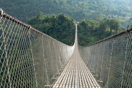 Kushma - Gyadi suspension bridge is the highest and longest suspension bridge in Nepal. It is 1,128 feet long and 384 feet above the Modi river in central Nepal. Stok Fotoğraf