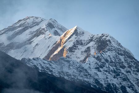 The beauty of the Sun Shining on the Himalaya Mountain Range in Nepal.