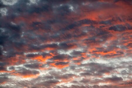 The beautiful colors of the sunrise shining on the underside of the clouds.