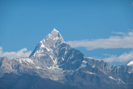 The beauty of the Machhapuchchhre Mountain in Central Nepal in the light of the morning sun.
